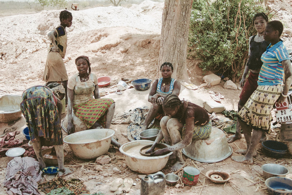 A group of women washes their clothes and also pans for gold in one of the goldmines near Bouda in Burkina Faso, March 2014