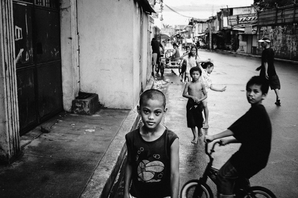 Children playing in the streets of the notorious Baseco compound slum area, Manila, Philippines, 2013
