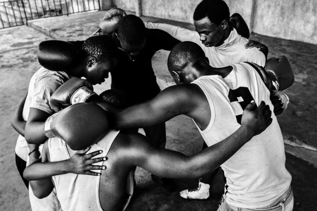 Boxers of the Club de l'Amitie gather after a training session, DR Congo, 2016