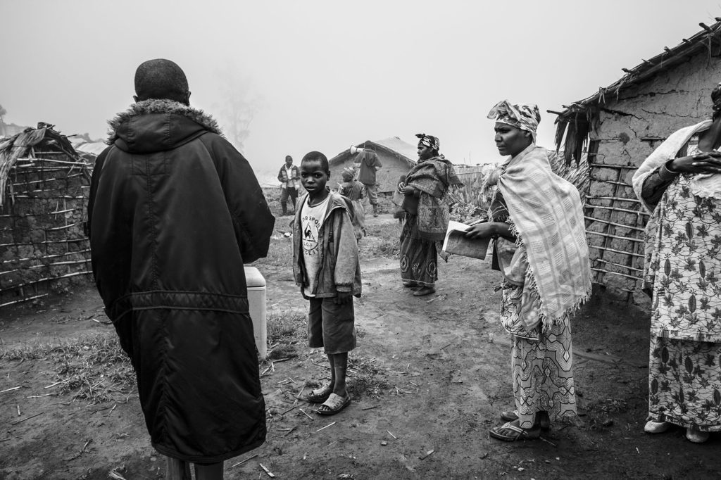 Village leaders conduct a polio vaccination campaign in a rebel-held village in Eastern DRC, 2016